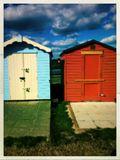 Blue and red Huts Stock Images