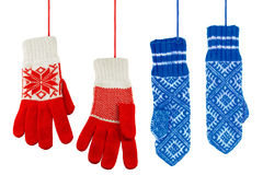 Blue and red knitted mittens Royalty Free Stock Images