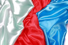 Blue and red and light green Silk cloth of wavy abstract backgro Royalty Free Stock Image