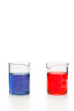 Blue and red liquid in beakers Royalty Free Stock Image