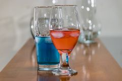 Blue and red liquid in glasswear royalty free stock photos