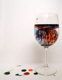 Blue and Red Liquid in Wine glass Stock Images