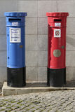Blue and red mailboxes Royalty Free Stock Images