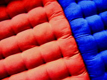Blue and red mattresses. Details of a red and blue mattress or cloth cushions stock photography