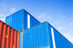 Blue and red metal Industrial cargo containers are stacked Stock Images