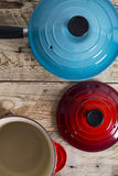 Blue and red open saucepans Stock Image