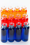 Blue, red and orange liquid in chemical lab test tubes on white background Royalty Free Stock Images