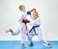 With blue and red overlays on his hands athletes train paired exercises karate. With blue and red overlays on his hands boys train paired exercises karate Royalty Free Stock Photos