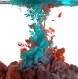 Blue and red paint in water Stock Photo