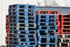 Blue and red pallets Stock Photography