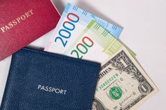 Blue and red passport with the dollar and the new Russian banknotes rubles or euros Royalty Free Stock Images