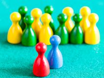 Blue and red pawns in front of other color pawns royalty free stock image