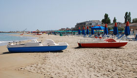 Blue and Red Pedalos. Brightly coloured pedalos on an Italian beach royalty free stock image