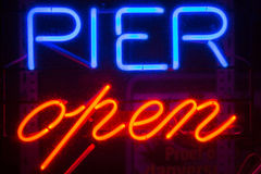 A blue and red Pier Open sign Stock Photo
