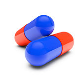 Blue and red pills Stock Photos
