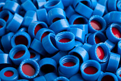 Blue and red plastic caps background stock photography