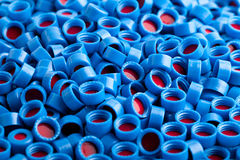 Blue and red plastic caps background Royalty Free Stock Photo