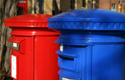Blue and red post boxes. Close crop image of brightly coloured blue and red post boxes at Windsor, Berkshire, UK Royalty Free Stock Photo