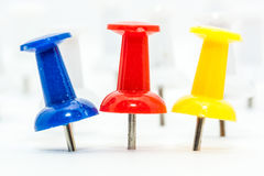 Blue and Red push pins. With white pins as back ground Stock Photography