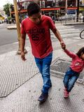 Blue and red, pushing opposites. Street photography, candid, Buenos Aires stock photo