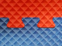 Blue and red puzzle with 3d geometric figures. Puzzle together of blue and red colors with 3d geometric figures Stock Photo