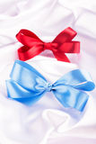 Blue and red ribbon satin bows Royalty Free Stock Photo