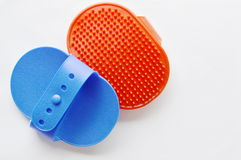 Blue and red rubber dog bath brush on white background Stock Photo