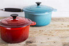 Blue and red saucepans Stock Photography