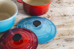 Blue and red saucepans and lids Royalty Free Stock Photography