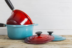 Blue and red saucepans with lids Stock Image