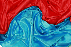 Blue and red Silk cloth of wavy abstract backgrounds Royalty Free Stock Photo