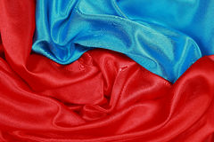 Blue and red Silk cloth of wavy abstract backgrounds Royalty Free Stock Photography