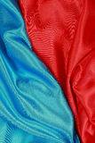 Blue and red Silk cloth of wavy abstract backgrounds Stock Photo