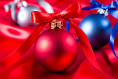 Blue, red and silver christmas balls on a silk cloth Stock Images