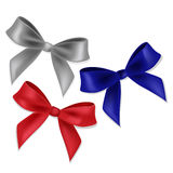 Blue, red and silver ribbons and bows. Stock Images