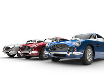 Blue, red and silver vintage cars - perspective studio shot stock illustration