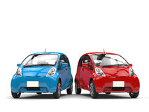 Blue and red small ecomonic electric cars side by side Stock Image