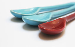 Blue and red spoons Stock Images