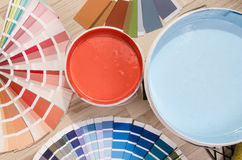 Blue and red swatches and paint on the floor. Royalty Free Stock Image
