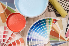 Blue and red swatches and paint on the floor. Royalty Free Stock Photography