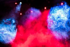 Blue and red theatrical smoke on stage. Lighting equipment. Theatrical performance or show.  stock photo