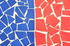 Blue and red trencadis. Broken tiles background. Catalan mosaic stock image