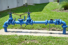 Blue and red valves and handle. A device that regulates, directs or controls the flow of a fluid. taken in florida Stock Photo