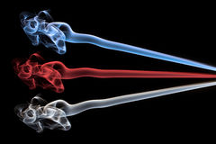Blue, red and white smoke abstract. On black background Royalty Free Stock Image