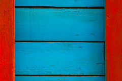 Blue-red wooden background. Blue with red wooden striped texture stock image