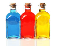 Blue, red, and yellow bottles Stock Photography