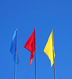 Blue, red and yellow flags Royalty Free Stock Images
