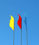 Blue, red and yellow flags Stock Image