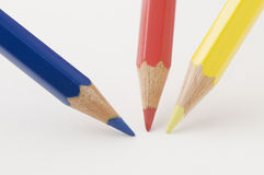 Blue red and yellow pencil tips on paper Stock Photo