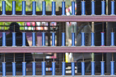 Blue reels of textile yarn thread at manufacturing machine. Royalty Free Stock Image